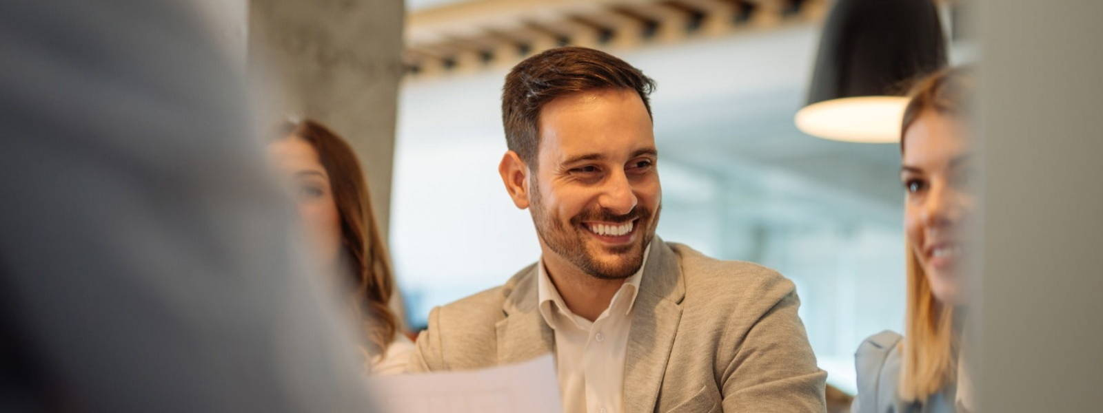 Man smiling in a meeting